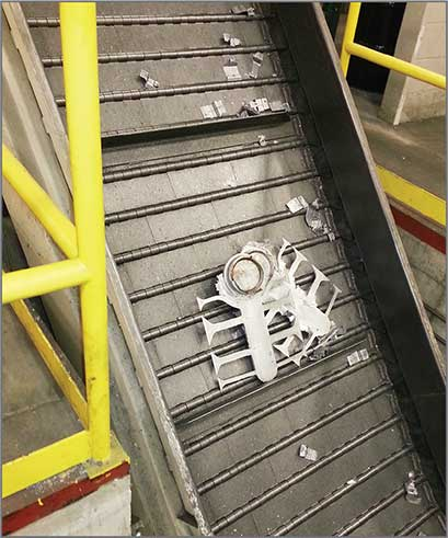 "Trim scrap elevated toward the furnace on a 21/2"" Pitch Steel Belt Z-Style Conveyor 